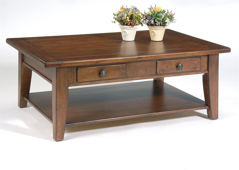 Treasures rectangular cocktail table in rustic cherry for Cocktail table accessories